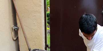 Mateo Nava, Design and Architecture Senior High School, Miami, FL — Site-specific performance; soil, muslin, wooden pedestal, shovel, shirt, pants