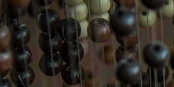 Matthew Fry, El Diamante High School, Visalia, CA — Wooden beads, acrylic paint, fishing line, metal hooks, stain