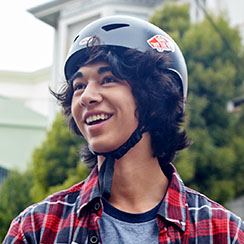 Student wearing a helmet and smiling